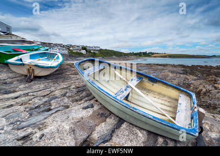 Small rowing boats lined up on the slipway at Portscatho on the Roseland Peninsula in Cornwall - Stock Photo