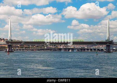 Golden Horn Metro Bridge with the Ataturk Bridge in the background, Istanbul, Turkey. - Stock Photo