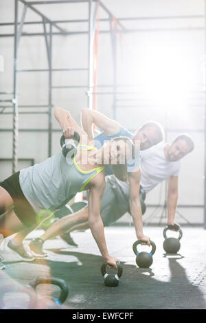 Confident people exercising in crossfit gym - Stock Photo