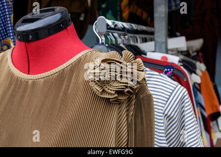 Vintage dresses hanging at the flea market in Greenwich, London England United Kingdom UK - Stock Photo