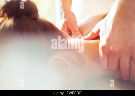 Close up masseuse massaging woman's neck - Stock Photo
