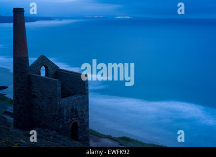 Last light at Wheal Coates tin mine, Chapel Porth with a view of St Ives in the distance. - Stock Photo