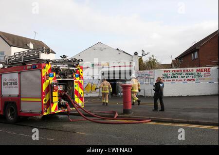 Fire Engine Truck Local Newsagents Shop Fire - Stock Photo