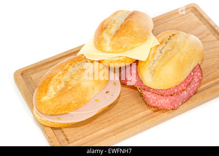 German bread rolls with mortadella, cheese and pepper cervelat on a wooden breakfast tray