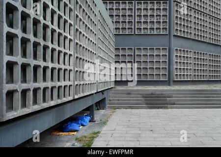Berlin, Germany, a homeless sleeping bag under the reconstruction the Kaiser Wilhelm Memorial Church- - Stock Photo