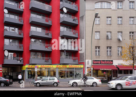 Berlin, Germany, reconstructed residential buildings and old building in the Karl-Marx-Strasse - Stock Photo