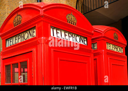 LONDON - MAY 13 2015:Two K2 kiosk Red telephone boxes in London, UK.Due to cost, around £35 14s 0d per kiosk, only - Stock Photo