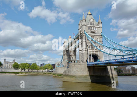 The Tower Bridge spanning over River Thames with the Tower of London in the background in London, UK. - Stock Photo