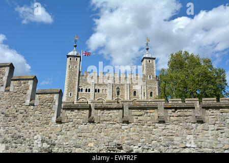 The outer curtain wall and the White Tower of The Tower of London in City of London, UK. - Stock Photo
