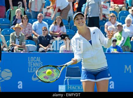 Belinda Bencic (Switzerland) hitting signed tennis balls into the crowd after her quarter final victory at Eastbourne, UK. 25th June, 2015. Aegon International tennis tournament.