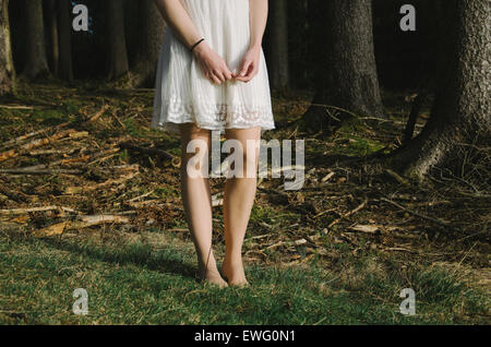 Female in White Dress Standing in Grass - Stock Photo