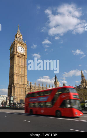 LONDON - MAY 14 2015:Red Bus under the Big Ben clock tower.It's the most popular landmark in the United Kingdom. - Stock Photo