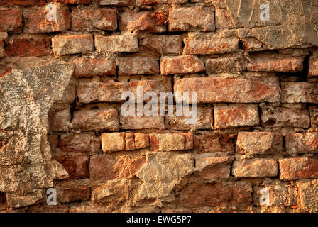 Rustic vintage brick wall in warm sunlight as a texture or background - Stock Photo