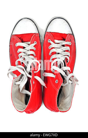 high-angle shot of a pair of red sneaker boots with white shoelaces on a white background - Stock Photo