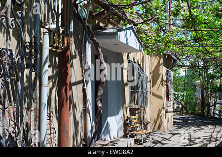 Typical Tbilisi yard in the sunny summer day. Georgia - Stock Photo