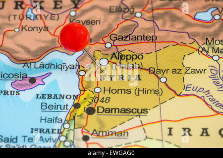 Close-up of a red pushpin on a map of Syria - Stock Photo