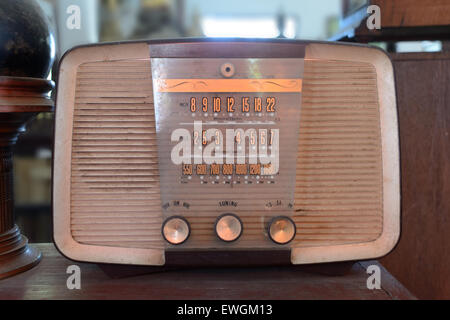 Retro radio on wooden table. - Stock Photo