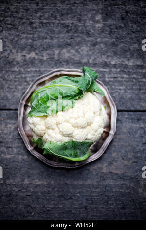 Fresh cauliflower on dark table - Stock Photo