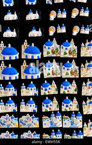 Souvenir fridge magnets on sale in a shop in the village of Oia Santorini Greece - Stock Photo