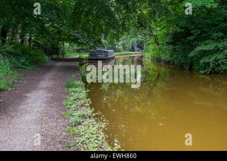 A moored canal boat on the Bridgewater Canal - Stock Photo