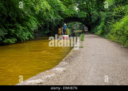 Bridgewater Canal going under a bridge with tow path  and railings - Stock Photo