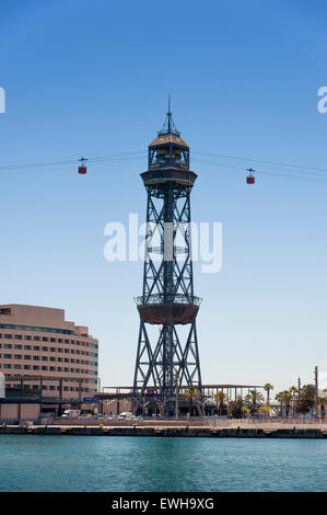 Cable Cars and tower over Port Vell Marina Harbour in Barcelona. Spain - Stock Photo