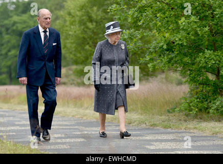Celle, Germany. 26th June, 2015. Britain's Queen Elizabeth (R) and Prince Philip walk past mass graves in front - Stock Photo