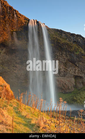 Seljalandsfoss waterfall at sunset, South Iceland - Stock Photo