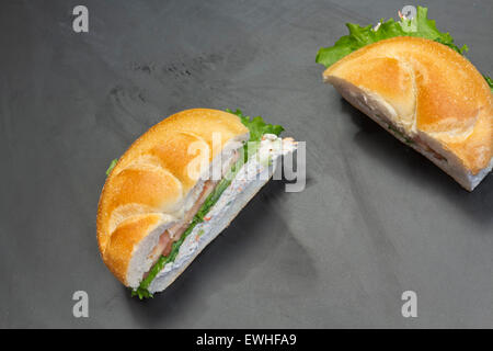 Bound seafood salad sandwich with mayo on a kaiser roll - Stock Photo