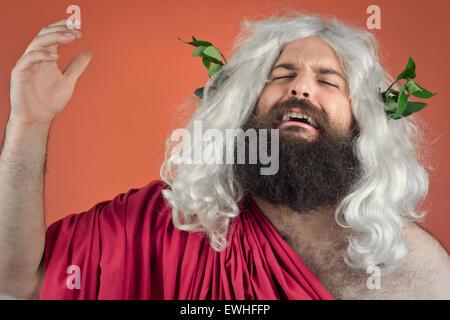 Crying zeus god or jupiter against orange background - Stock Photo
