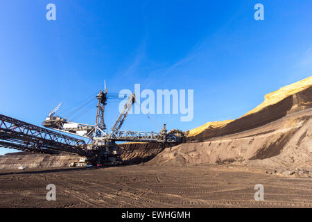 Giant wheel of bucket wheel excavator in a brown coal open pit mine. - Stock Photo