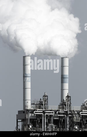Smoke emission from factory pipes - Stock Photo