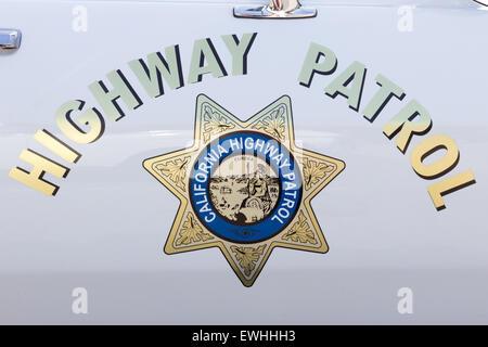 California Highway Patrol badge on a vintage US police car. - Stock Photo