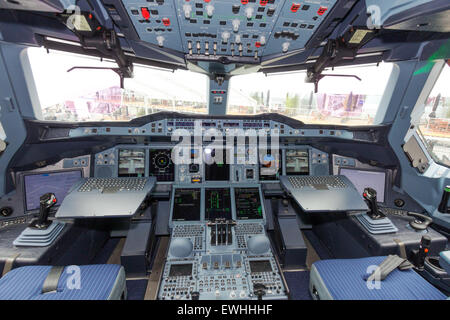 Airbus A380 cockpit. The A380 is the largest passenger airliner in the world. - Stock Photo