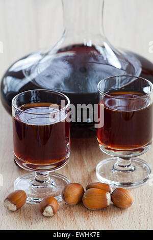 Homemade hazelnut liqueur in a carafe and a glass Stock Photo, Royalty ...