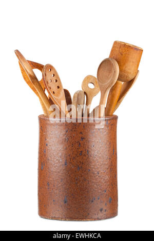 Old clay pot with wooden kitchen utensils isolated on white Background - Stock Photo