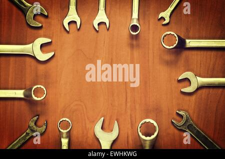 wrenches frame wrenches and ring spanners in several different sizes on natural wooden background - Wrench Picture Frame