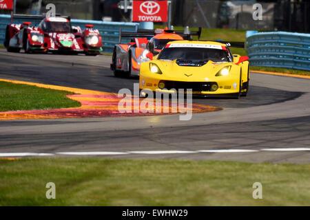March 14, 2015 - Watkins Glen, NY, U.S. - Watkins Glen, NY - Jun 26, 2015: The Corvette Racing races through the - Stock Photo
