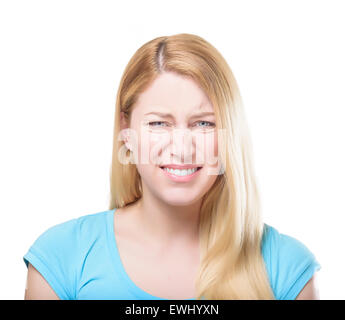 Blonde woman grimacing. - Stock Photo