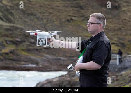 man holding dji phantom remote drone camera flying in Iceland - Stock Photo