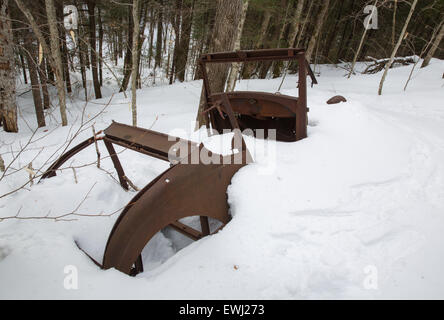 Rusted car in the Eastman Brook drainage of Thornton, New Hampshire USA during the winter months. This is possibly - Stock Photo