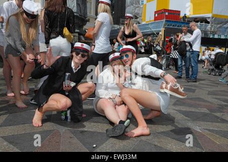 Copenhagen, Denmark. June 26, 2015. Danish students celebrate their high school graduation. A dance around and a - Stock Photo