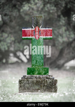 Old weathered gravestone in the cemetery - Kenya - Stock Photo