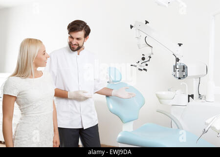 Dentist showing to client working place - Stock Photo