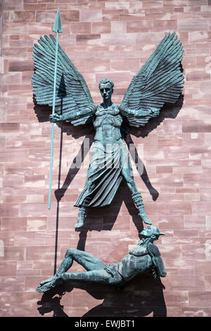 St Michael's Victory over the Devil, a sculpture by Sir Jacob Epstein, on the side of the new Coventry Cathedral - Stock Photo