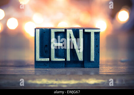 The word LENT written in vintage metal letterpress type on a soft backlit background. - Stock Photo