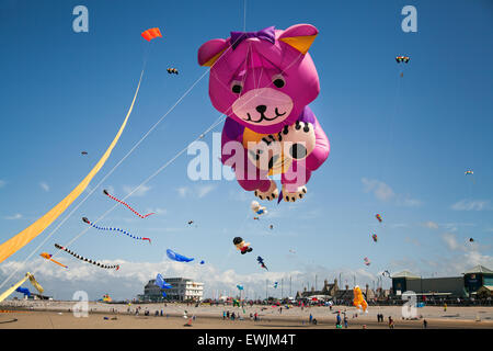 Morecambe, Lancashire, UK 27th June, 2015. Catch The Wind Kite Festival an annual festival on Morecambe seafront, when for the whole day the skies are full of the most spectacular shapes, colours and creations.  Featured were single line kites of all kinds and sizes, including a massive giant teddy bear. Stock Photo
