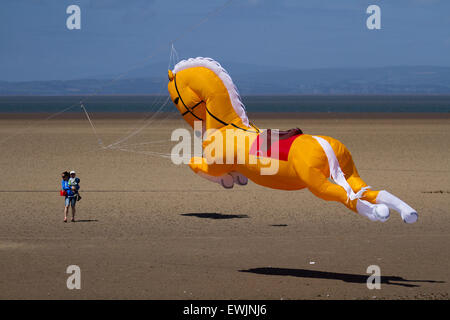 Horse kites galloping over the beach at Morecambe, Lancashire, UK 27th June, 2015. Inflatables Pegasus galloping horse Peter Lynn kite at the Catch The Wind Kite Festival an annual event on Morecambe seafront, when for the whole day the skies are full of the most spectacular shapes, colours and creations. Stock Photo