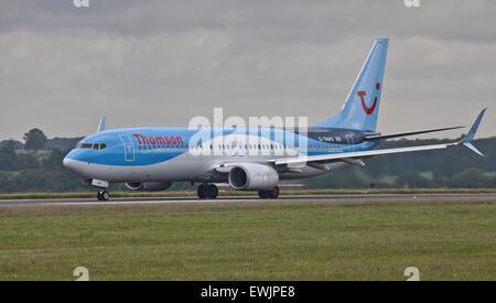 Thomson Airways Boeing 737 G-TAWO taking off from London-Luton Airport LTN - Stock Photo