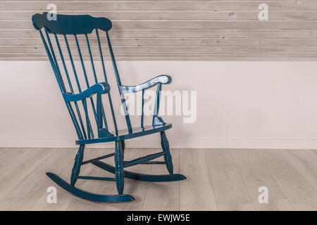 Blue rocking chair in a living room - Stock Photo